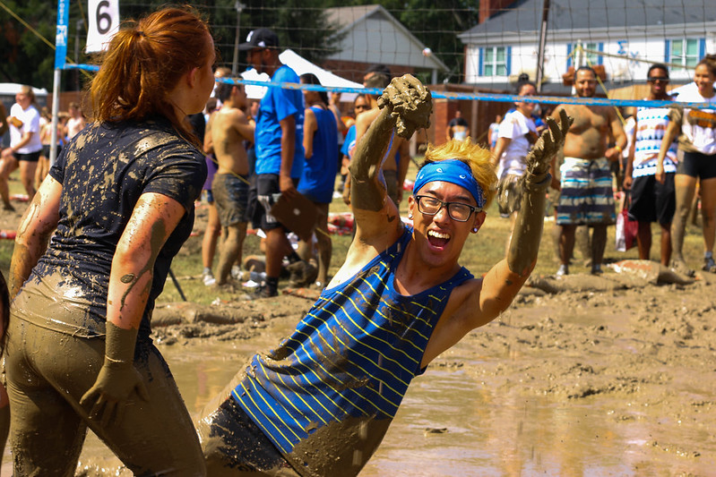 Student throwing up mud in the air excitedly