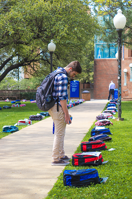 A student reading signs on a bag
