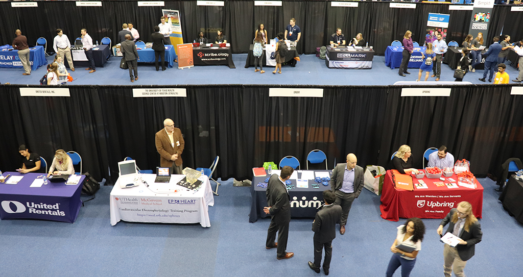 job fair pic with tables and people