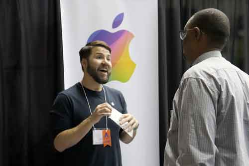 Apple representative talking to student