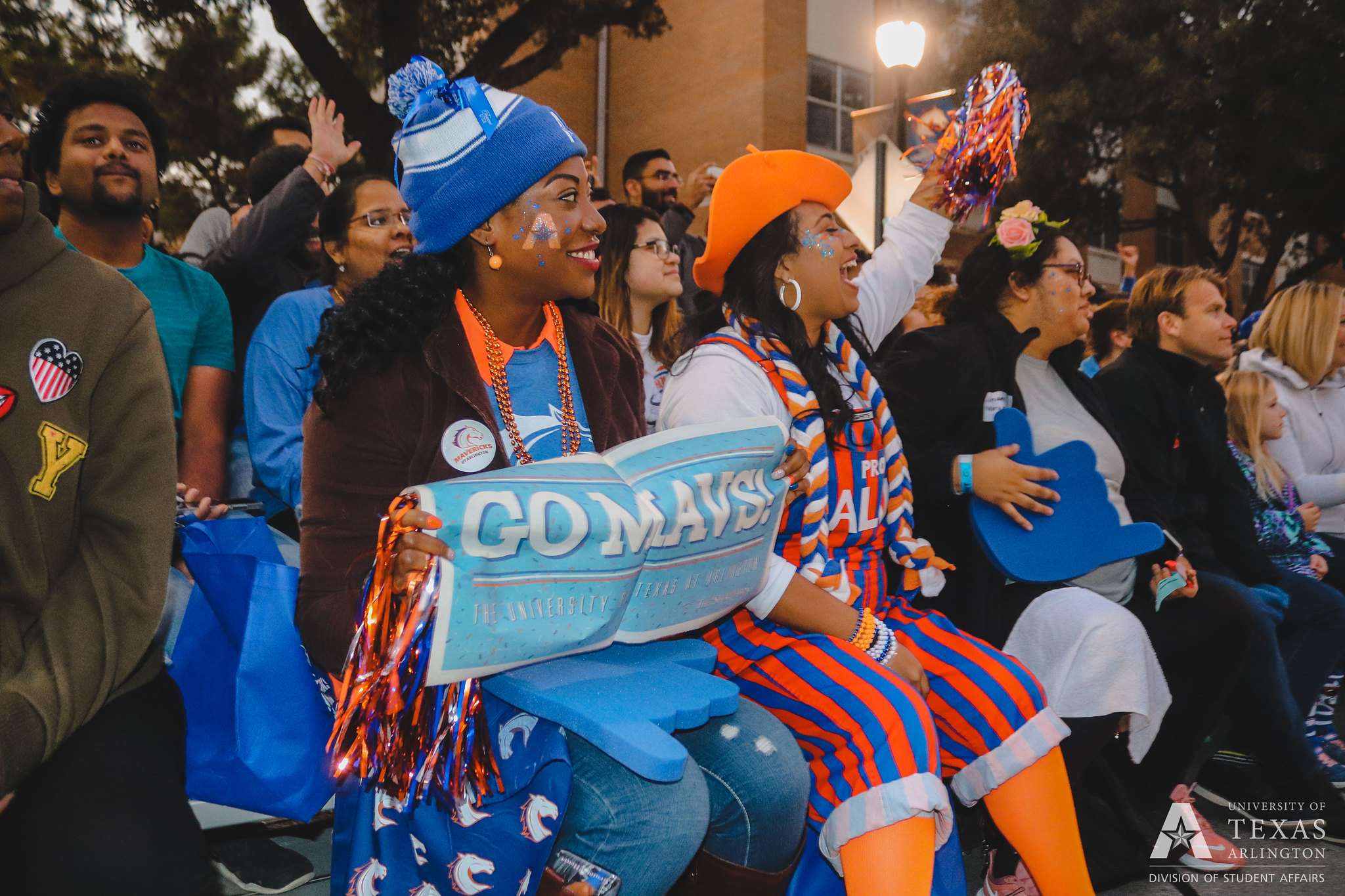 UTA students and a wrangler, a student spirit group, cheer while watching the UTA Homecoming Parade