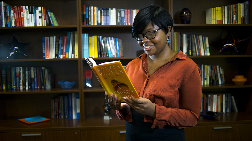 A student reading a book at the Leadership library