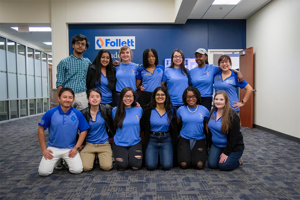 The Follett students leadership center student staff posing in front of the leadership center.