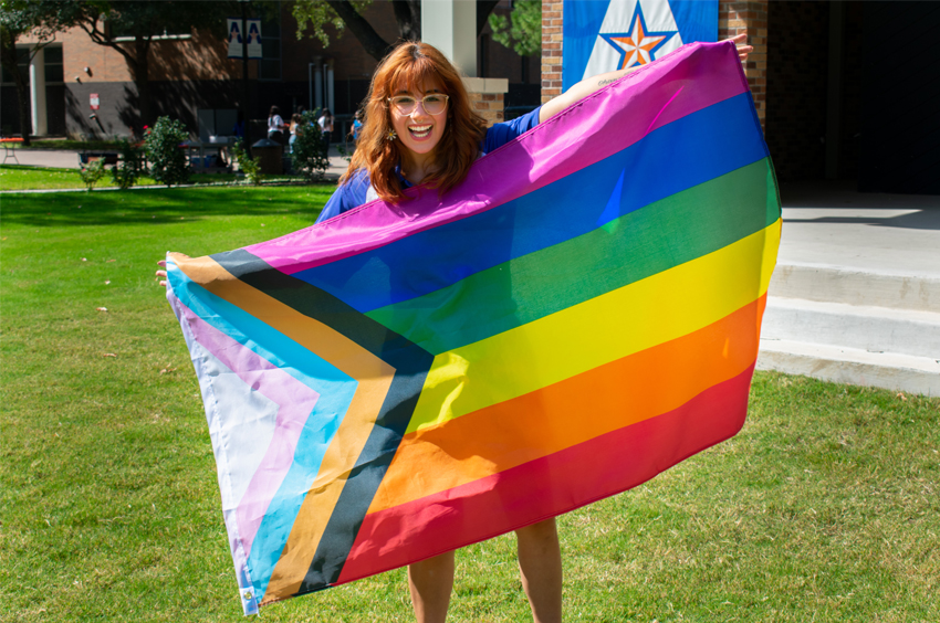 Student holding up LGBTQA flag.