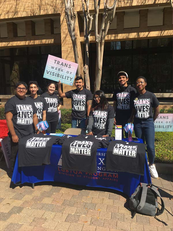7 people, wearing black shirts, tabling for Trans Lives Matter in front of the University Center