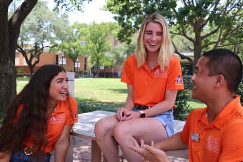 Orientation leaders sitting and talking outside
