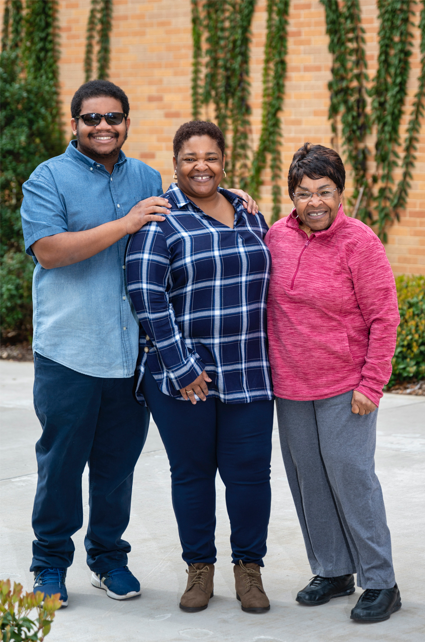 A young man with his mom and grandma.