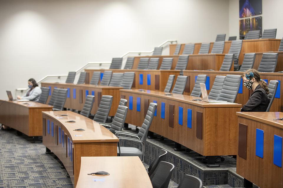 socially distanced students in the student government chambers