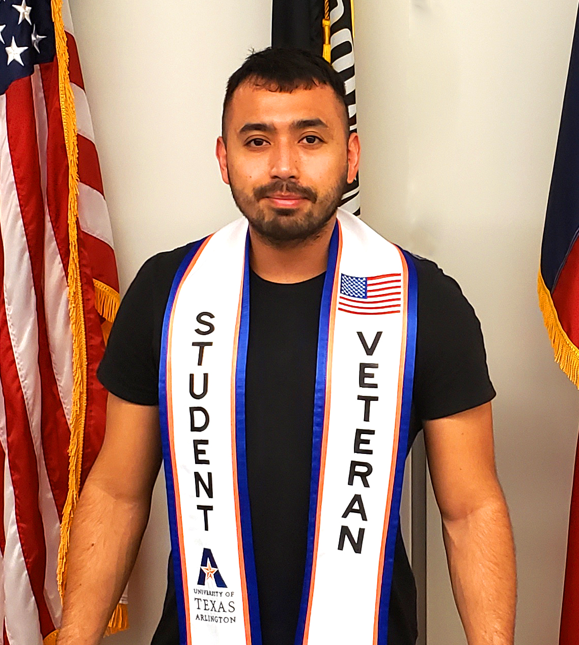 """Student wearing a graduation stole that says """"Student Veteran"""" on it."""