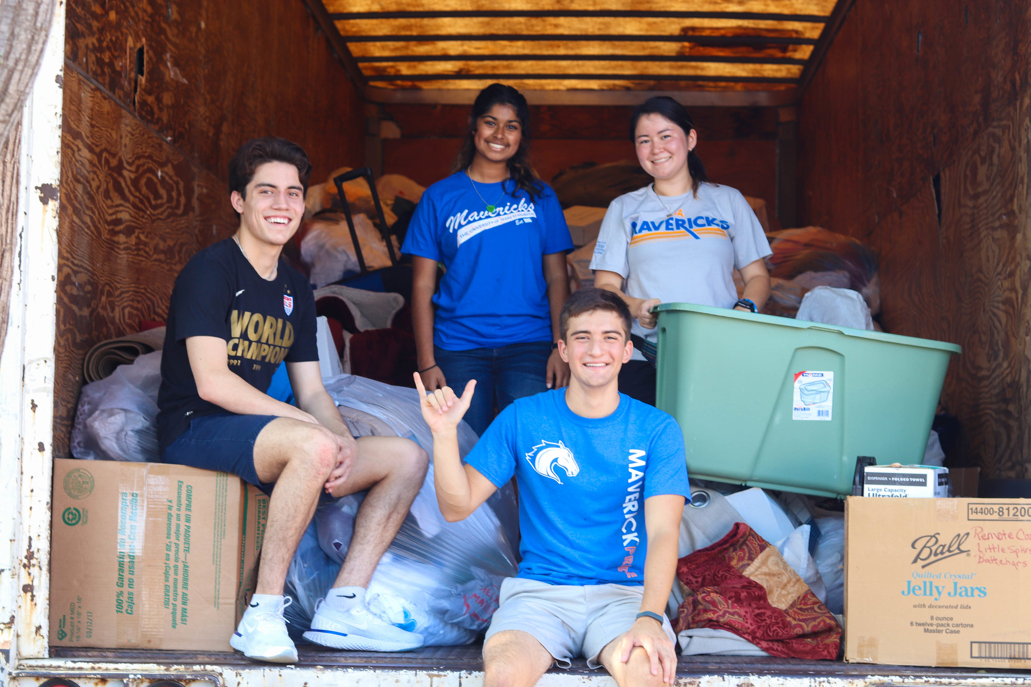 UTA students with cardboard boxes volunteering