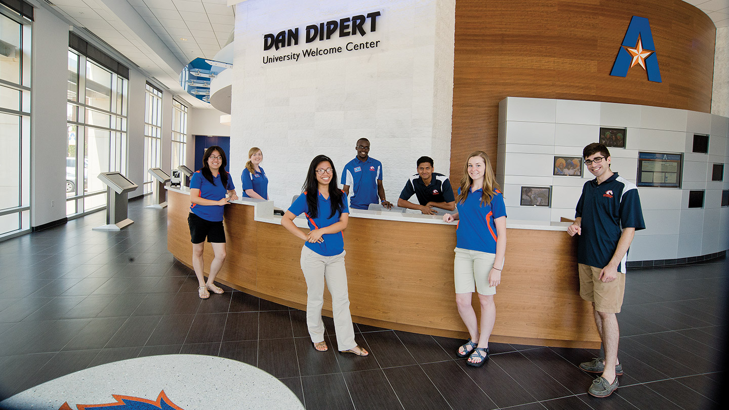 Tour guides in welcome center at UTA campus